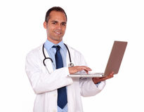 Charming medical doctor working on his laptop Royalty Free Stock Photo