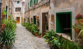 Charming mediterranean street of old town Valldemossa on Mallorc Stock Photography