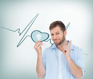 Charming model holding a bulb in right hand Stock Photography