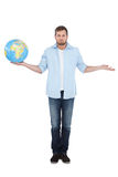 Charming model holding a globe and making faces Stock Photo