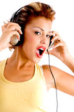 Charming model listening to music with headphone Stock Images