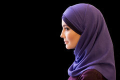 Charming Muslim woman in a scarf on her head in profile. Black background Royalty Free Stock Photography