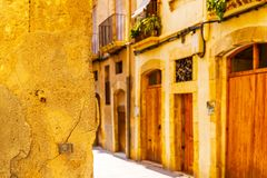 Charming narrow street, street with colorful facades of building Stock Photos