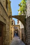 Charming narrow street in the old town of Rhodes. Rhodes island, Greece stock image