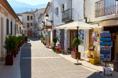 Charming narrow street with souvenir shops of a Guadalest. Spain Stock Images