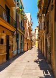Charming narrow street, street with colorful facades of building Stock Photo