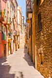 Charming narrow street, street with colorful facades of building Stock Image