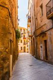 Charming narrow street, street with colorful facades of building Stock Images