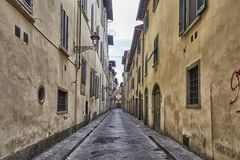 Charming narrow streets of Florence town in Tuscany, Italy royalty free stock photo