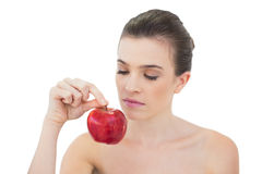 Charming natural brown haired model holding an apple Stock Photos