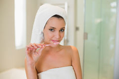 Charming natural brown haired woman using a toothbrush Stock Image