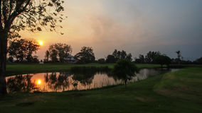 The charming of the nature. The sun is reflecting on the little lake with the surrounding of the green garden Stock Photography