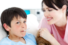 Charming nurse taking little boy's temperature Royalty Free Stock Images