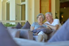 Charming old couple in hotel Stock Photos