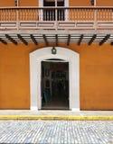 Old Spanish door with a door knocker in San Juan, Puerto Rico. Charming old Spanish door with a door knocker in San Juan, Puerto Rico royalty free stock photos
