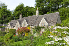 Charming old stone houses with beautiful, colourful flower gardens Royalty Free Stock Images