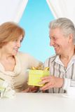 Charming older couple resting in the bedroom Stock Images