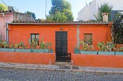 Charming orange house. PALMA DE MALLORCA, BALEARIC ISLANDS, SPAIN - SEPTEMBER 25, 2016: Charming orange house with green cactus plants in El Terreno narrow Stock Image