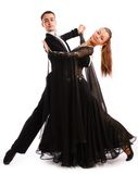 A charming   pair dances in good-looking suits Royalty Free Stock Photos
