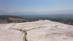 Charming Pamukkale pools in Turkey. Pamukkale contains hot springs and travertines, terraces of carbonate minerals left royalty free stock photo