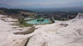 Charming Pamukkale pools in Turkey. Pamukkale contains hot springs and travertines, terraces of carbonate minerals left royalty free stock photos