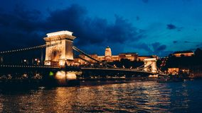 Charming panorama view of the shining Chain Bridge on River Danube and buldings in Budapest, Hungary at night. stock photography