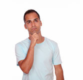 Charming pensive young man looking up Royalty Free Stock Photo