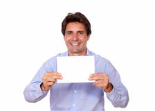 Charming positive man holding a blank card Stock Images