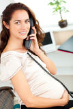 Charming pregnant businesswoman talking on phone Royalty Free Stock Photos