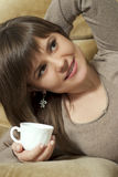 Charming pretty beautiful woman holds a cup Stock Photography