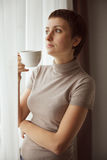 Charming Pretty woman drinking coffee Stock Photo