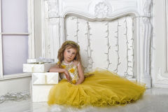Charming princess girl in a yellow dress Stock Photography
