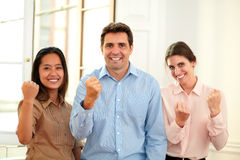 Charming professional team with winning sign Royalty Free Stock Images