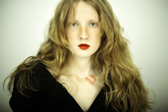 Charming red girl with freckles Stock Photo