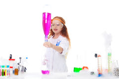 Charming red-haired girl posing as scientist Royalty Free Stock Photography