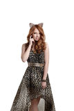 Charming red-haired girl posing in catwoman outfit Royalty Free Stock Images