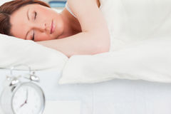 Charming red-haired woman sleeping Stock Photos