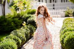 Beautiful young girl outdoors. stock photo