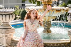 Beautiful young girl outdoors. royalty free stock image