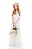 Charming redhead woman in dress holding flowers Royalty Free Stock Image