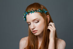 Charming redhead woman with hoop on her head Stock Images