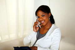 Charming relaxed young woman speaking on phone Royalty Free Stock Photo