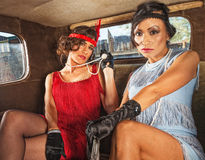 Charming Retro Ladies in Car. Pair of charming 1920s flappers inside car Royalty Free Stock Photography