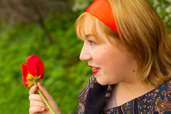 Charming rosy-cheeked young woman dressed in Russian style with Stock Photos