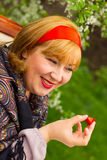 Charming rosy-cheeked young woman dressed in Russian style with Royalty Free Stock Image