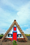 Charming rural house. A house with a thatched gable roof. Adorn Stock Image
