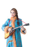 Charming Russian girl playing balalaika in studio Royalty Free Stock Image