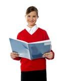 Charming school kid reading book Royalty Free Stock Photo