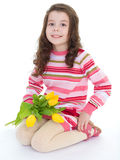 Charming schoolgirl pereds bouquet Royalty Free Stock Image