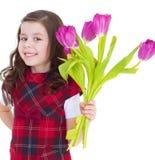 Charming schoolgirl pereds bouquet Stock Photo
